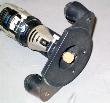 A garnite bit will make a cleaner hole than a router bit or sanding drum.